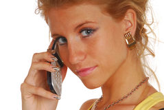 Blond girl with a mobile phone Stock Images
