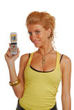 Blond girl with a mobile phone Royalty Free Stock Photography