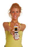 Blond girl with a mobile phone Stock Photography