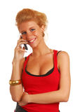 Blond girl with a mobile phone Stock Photos