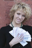 Blond girl with money Stock Images