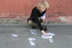Blond girl with money Stock Photography