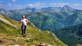 Blond girl in mountains Stock Photos