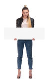 Blond girl with nameplate on white background. Blond girl with big nameplate on white background Royalty Free Stock Photos