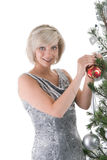 Blond girl near christmas tree Stock Photos