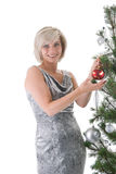 Blond girl near christmas tree Royalty Free Stock Photography
