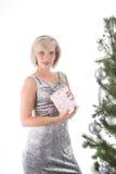 Blond girl near christmas tree Stock Image