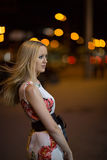 Blond girl at night city stock images