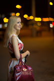 Blond girl at night city Stock Photo