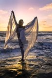 Blond girl by the ocean stock image