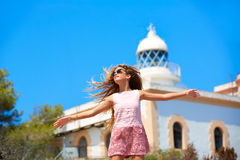 Blond girl open hands in Mediterranean Lighthouse. Feeling the wind in spain Stock Images