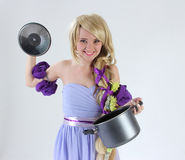 Blond girl with pan Stock Photography