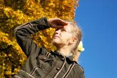 Blond girl peering into ... royalty free stock photos