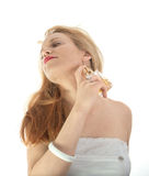 Blond girl with perfume Stock Photography