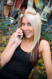 Blond Girl on the Phone Stock Images