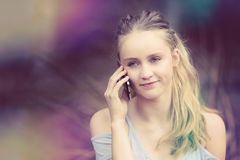Blond Girl on Phone Stock Photography