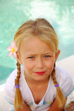 Blond girl with pigtails Stock Photos