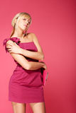 Blond girl in pink Stock Image