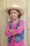 Blond girl in pink, arms crossed Royalty Free Stock Image