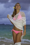 Blond girl in pink bikini and chiffon Royalty Free Stock Image