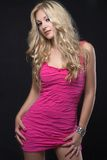 Blond girl in pink clothing Royalty Free Stock Image