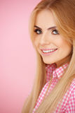 Blond girl on pink with copyspace Royalty Free Stock Images