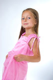 Blond girl  in pink dress Royalty Free Stock Image
