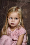 Blond girl in a pink dress Royalty Free Stock Photos