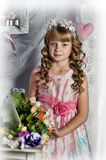 Blond girl in a pink dress  with flowers Royalty Free Stock Images
