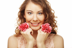 Blond girl with pink flower on white background Royalty Free Stock Image