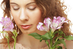 Blond girl with pink flower on white background Royalty Free Stock Photo