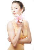 Blond girl with pink flower on white background Royalty Free Stock Photography