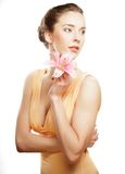 Blond girl with pink flower on white background Stock Photo