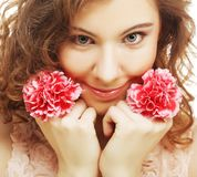 Blond girl with pink flower on white background Royalty Free Stock Images