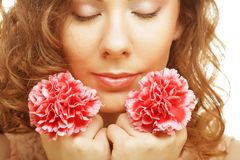 Blond girl with pink flower on white background Stock Image