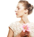 Blond girl with pink flower on white background Royalty Free Stock Photos
