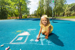 Blond girl play with chalk Royalty Free Stock Image