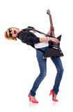 Blond girl playing her electric guitar Stock Photo
