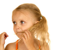 Blond girl playing with her hair in her mouth Stock Photos