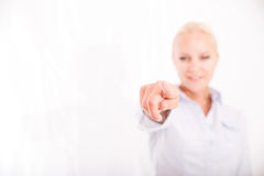 Blond girl pointing finger Royalty Free Stock Photos