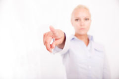Blond girl pointing finger Royalty Free Stock Photography