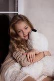 Blond girl with polar bear toy Stock Photos
