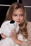 Blond girl with polar bear toy Stock Image