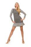 Blond girl in polka dot dress isolated on white Stock Photos
