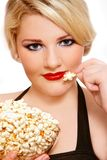 Blond girl with popcorn Stock Photo