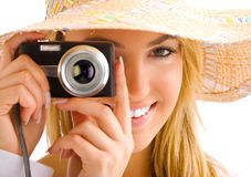 Blond girl portrait with camera. And hat Royalty Free Stock Photo
