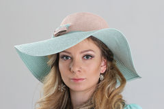 Blond girl, portrait in turquoise hat Stock Images