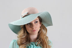 Blond girl, portrait in turquoise hat Stock Image