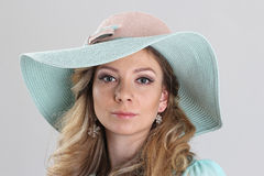 Blond girl, portrait in turquoise hat Stock Photography