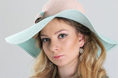 Blond girl, portrait in turquoise hat Royalty Free Stock Image
